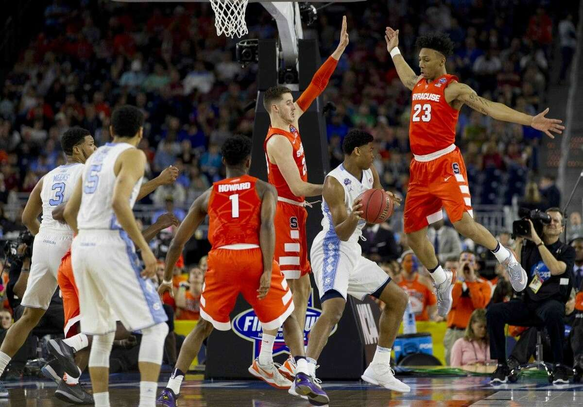 North Carolina forward Kennedy Meeks is pressured by the Syracuse defense during the first half of the NCAA Final Four semifinal Saturday afternoon.