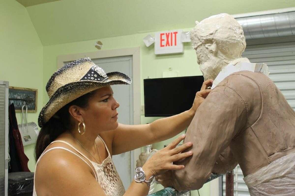 Shirley Scarpetta working on the sculpture of Ken Walden.