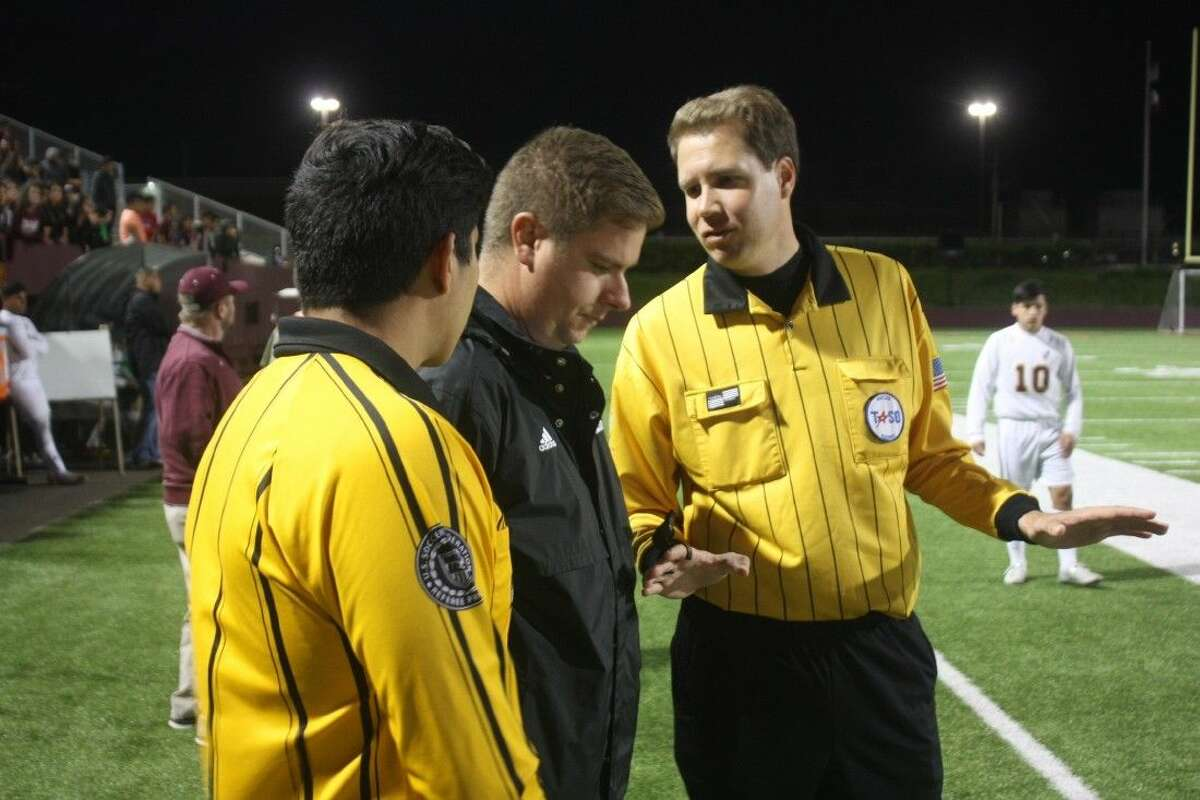 A member of the Deer Park coaching staff receives an explanation from the lead referee on why no yellow cards were issued after some brief pushing and shoving during the second half of Friday night's Area championship defeat.