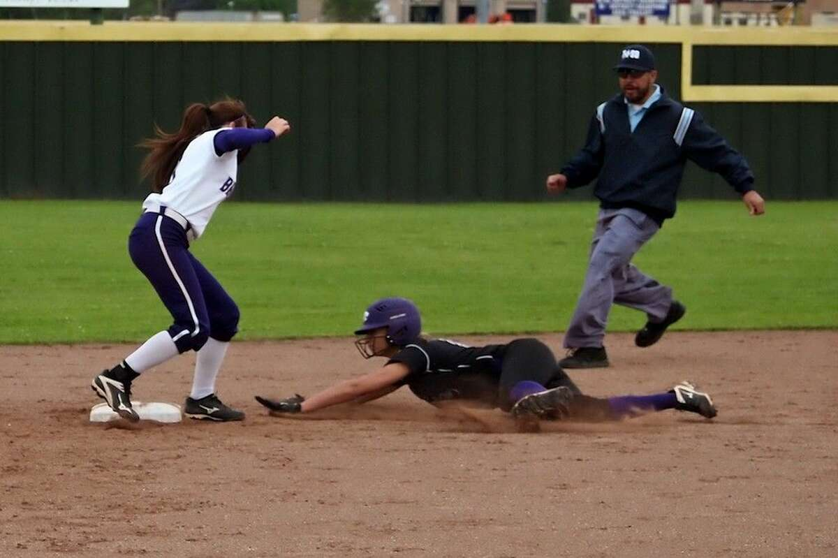 Humble's Emily Nelson steals second in the fourth inning at Dayton on Friday, April 1, 2016.
