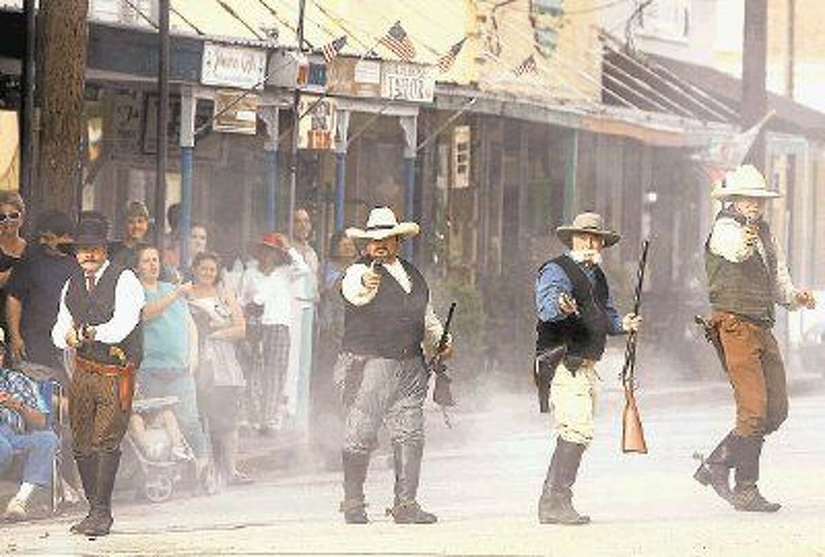 Shooters reenact the final battle in the Jaybird-Woodpecker War that took place in 1889, on the 125th anniversary of the battle in Richmond.
