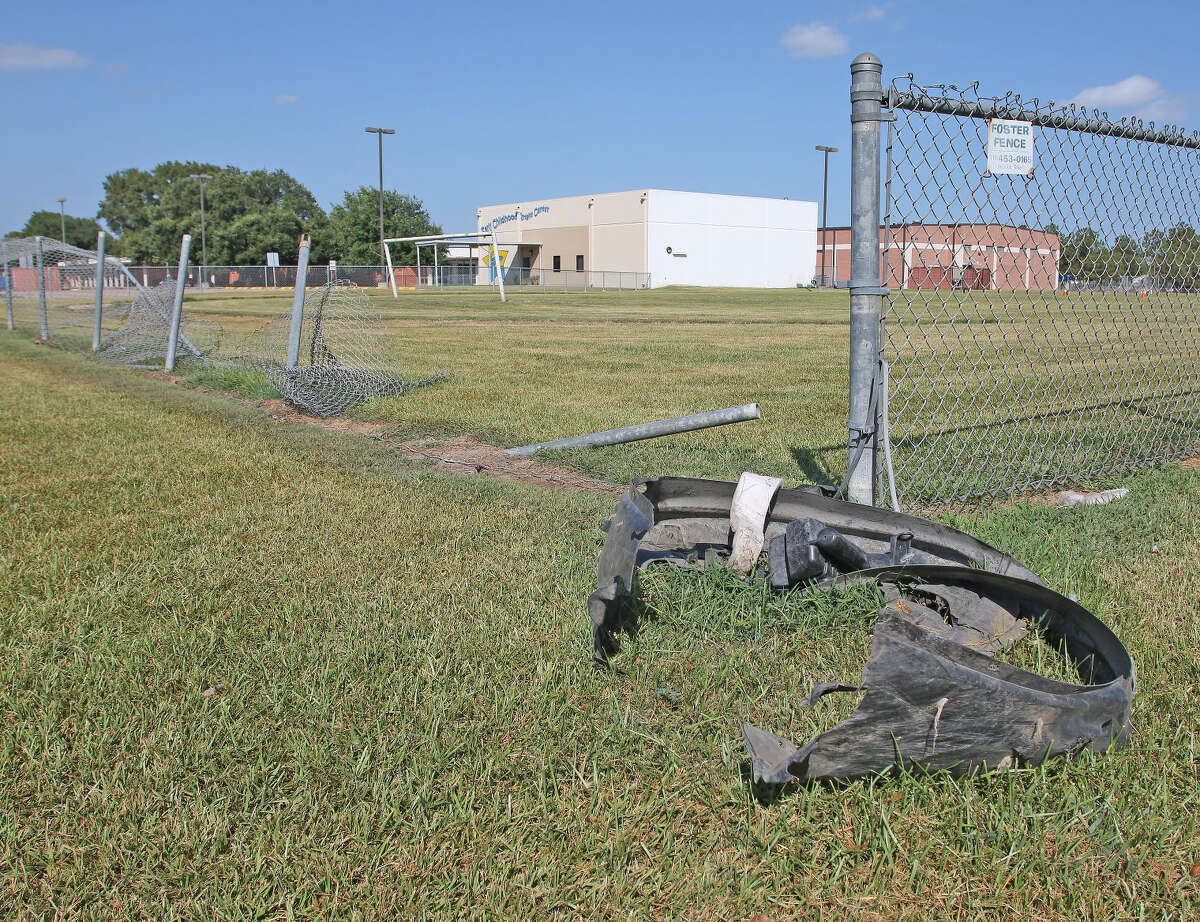 The fence near the soccer field at Whitcomb Elementary School at Reseda and Thunderbay Drive is still damaged after a car chase ended here on July 2nd.