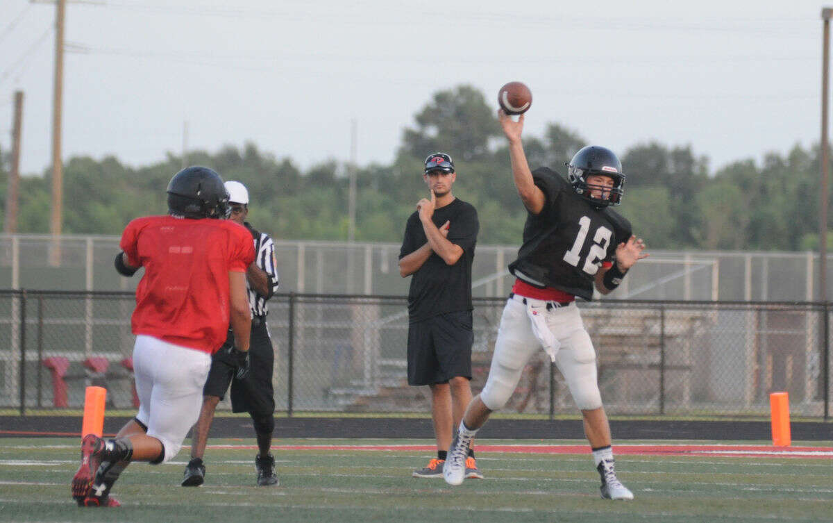 Porter's Jake Hall fires a pass against Huffman in a scrimmage at Falcon Stadium in Huffman on Friday.