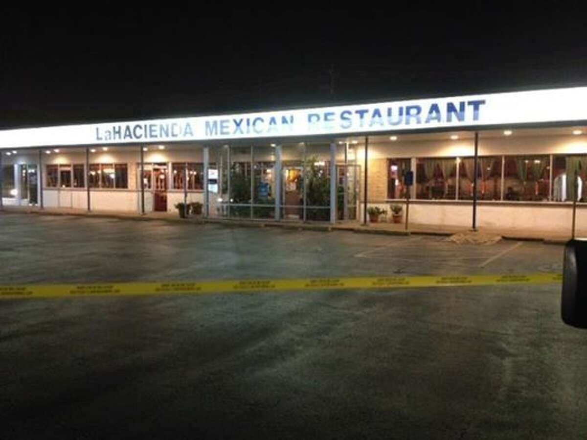 One person was killed and two others when armed robbers opened fire at in the kitchen of a popular Mexican restaurant.