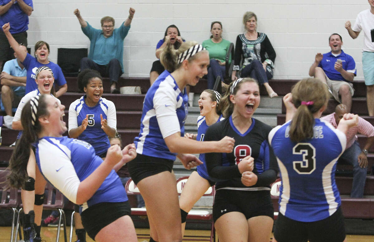 Oak Ridge players celebrate after defeating Concordia Lutheran 30-28 in the opening set during a game at the Magnolia Volley Battle at Magnolia High School Friday. To view or purchase this photo and others like it, visit HCNpics.com.