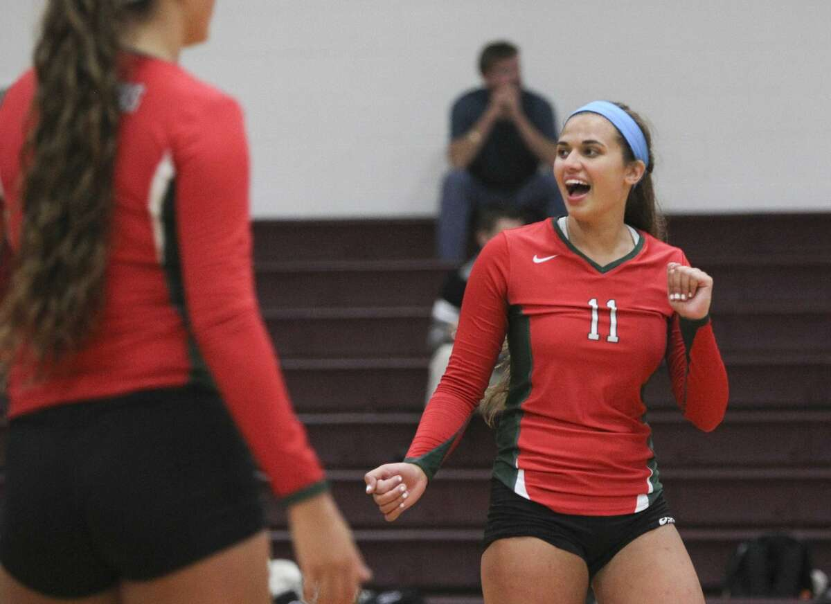 The Woodlands' Courtney Quinn (11) celebrates after a point during a game against Willis in the Magnolia Volley Battle at Magnolia High School Friday. The Woodlands won the game two sets out of three. To view or purchase this photo and others like it, visit HCNpics.com.