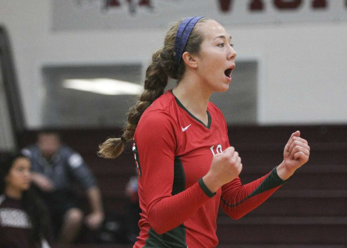 The Woodlands' Julia Pasch (13) celebrates after an ace during a game against Willis in the Magnolia Volley Battle at Magnolia High School Friday. The Woodlands won the game two sets out of three. To view or purchase this photo and others like it, visit HCNpics.com.