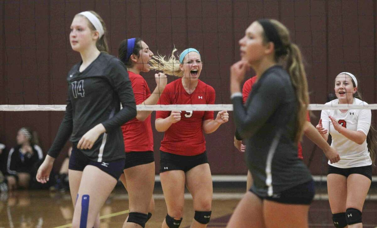 Tomball's Tara Jenkins celebrates after a point during a game at the Magnolia Volley Battle at Magnolia High School Friday. To view or purchase this photo and others like it, visit HCNpics.com.