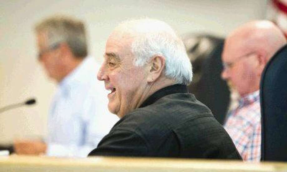 Precinct 1 Commissioner Mike Meador laughs at a joke during the county's budget meeting Tuesday. Photo: Jason Fochtman