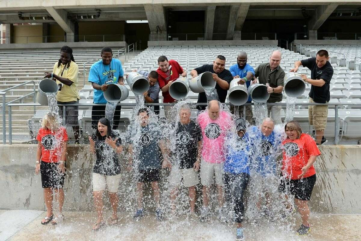 From left to right, associate superintendent Teresa Hull, general counsel Marney Sims, associate superintendents Roy Garcia and Stuart Snow, superintendent Dr. Mark Henry, and associate superintendents Dr. Deborah Stewart, Roy Sprague and Dr. Linda Macias accept the ALS Ice Bucket Challenge on Aug. 20 at the Berry Center.