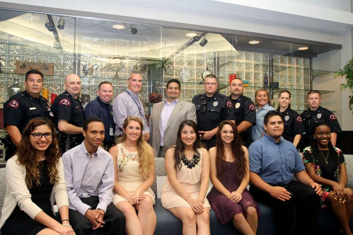 Pictured from left to right (front): Scholarship recipients Ana Ortiz, Dobie; Quentin Sessor, Dobie; Sadie Burt, Memorial; Glenda Rivera, Dobie; Dakota Fontenot, South Houston; Juan Pedraza, Dobie; and Dominique Nsibu, Memorial.Back row: Pasadena ISD Police Captains David Garza and Bill McMahan; Officers Jason Grice and Trae Morris; A.C. Collins Ford general sales manager and top scholarship sponsor Anthony Loya; Officers Mark Mills, Michael Spray, Amber Murphy, Keri Smith and Kyle Wilson.