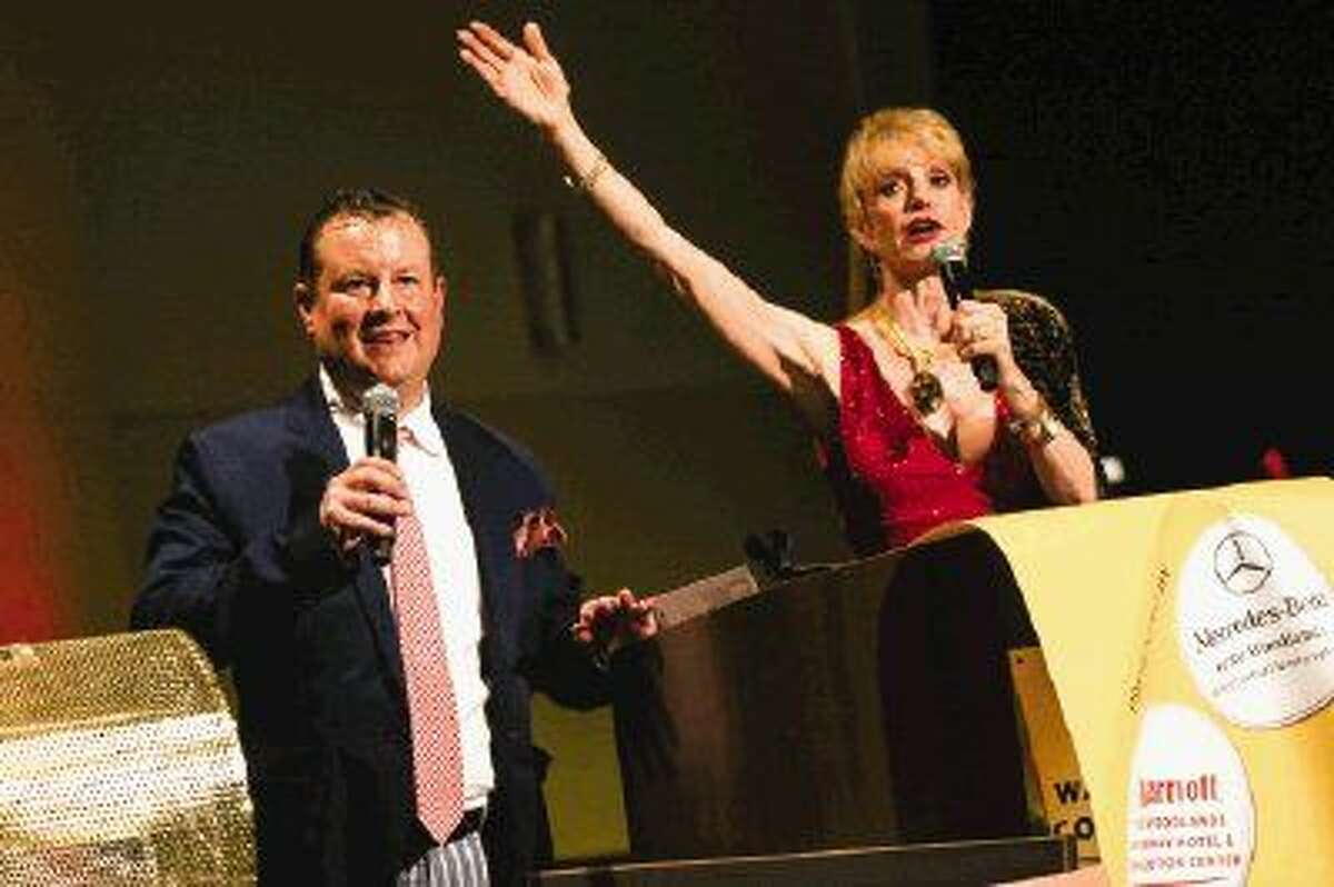 Emcees Nick Wolda, President of The Woodlands Convention and Visitors Bureau, and Nelda Blair, former Chair of The Woodlands Township Board of Directors, speak during the Art Dash Party on Friday at The Woodlands Waterway Marriott Hotel & Convention Center.