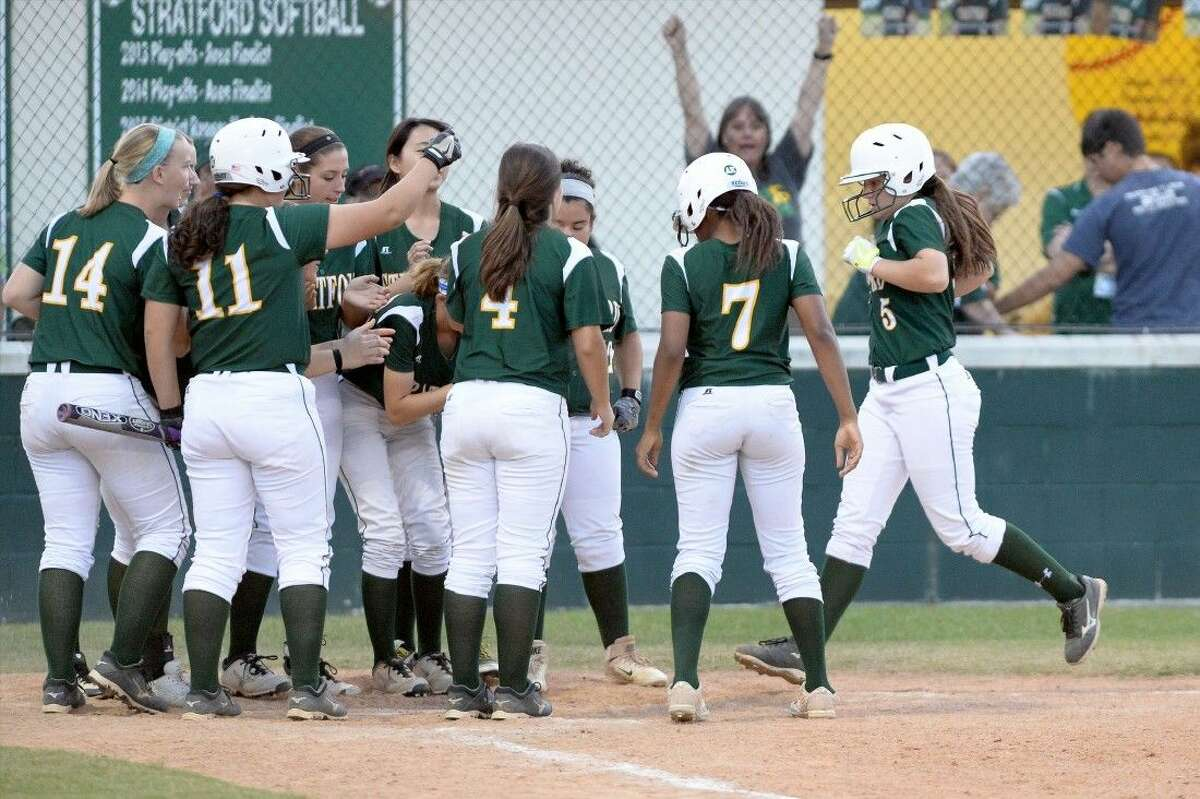 Brann's teammates greet her at the plate after her homerun. The dinger was not enough, however, for the Spartans to overcome an early Brenham lead.
