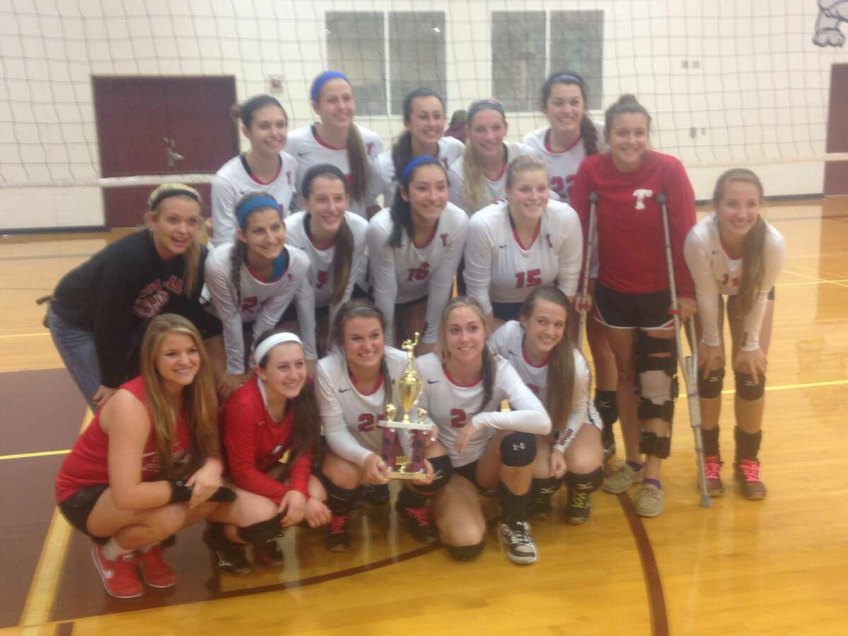 The Tomball Volleyball team poses with their Silver Bracket Championship trophy after beating Willis on Saturday. Photo By Joshua Koch/HCN.