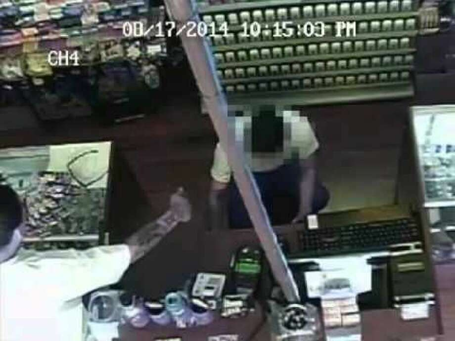 Harris County Sheriff's Office robbery investigators need the public's help in identifying and locating a suspect believed to be responsible for robbing at gunpoint several smoke shops in Harris County. Photo: Courtesy Of HCSO