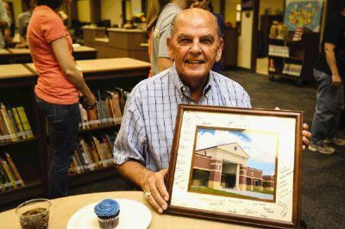 Retired Conroe ISD educator Charlie Patterson, for whom Patterson Elementary is named, celebrates his 76th birthday at a surprise party Friday give by the principal and teachers at Patterson Elementary which opens for school Monday. The staff presented him with a photograph of the school signed by them.