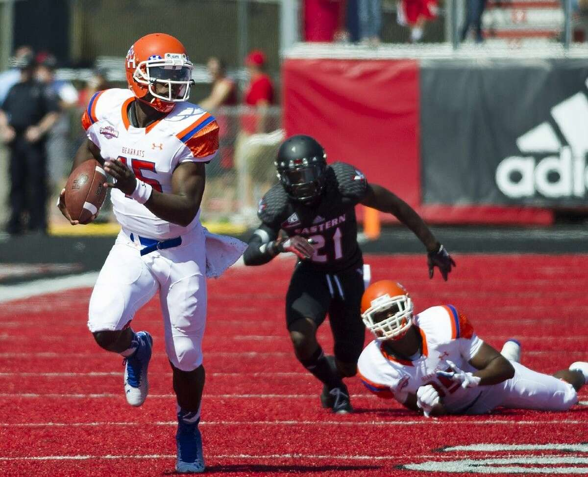 Sam Houston State quarterback Jared Johnson runs 53 yards for a touchdown against Eastern Washington in the first half of an NCAA college football game in Cheney, Wash., Saturday.