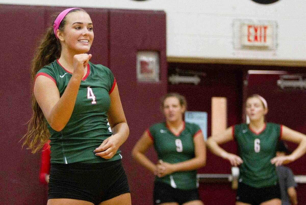The Woodlands' Kendall Cook (4) celebrates after defeating Klein Collins during a game at the Magnolia Volley-Battle at Magnolia High School Saturday. To view or purchase this photo and others like it, visit HCNpics.com.