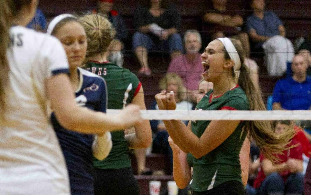 The Woodlands' Courtney Quinn (11) celebrates after a point during a game at the Magnolia Volley-Battle at Magnolia High School Saturday. To view or purchase this photo and others like it, visit HCNpics.com.