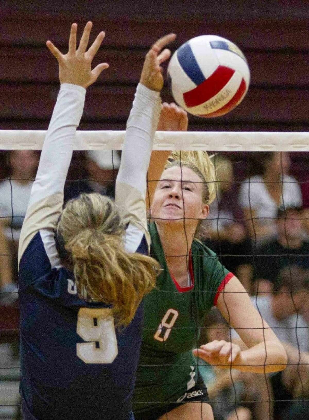 The Woodlands' Rachel Reed (8) gets a shot past Klein Collins' Brooke Regalado (9) during a game at the Magnolia Volley-Battle at Magnolia High School Saturday. To view or purchase this photo and others like it, visit HCNpics.com.