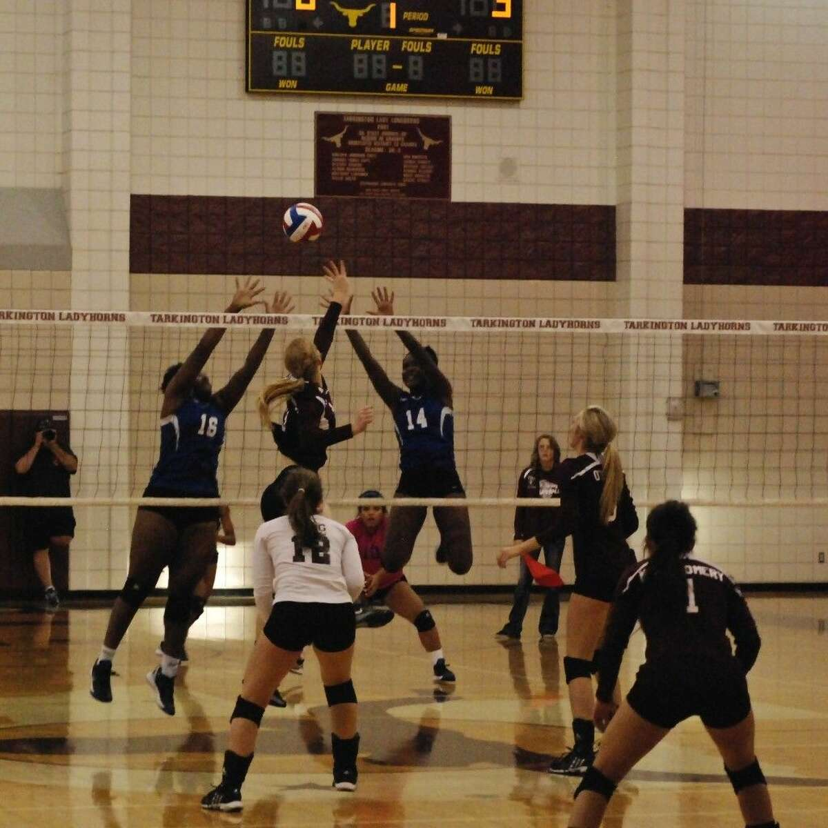 Claire Chapman dinks one over for the ninth point in set one against Sterling, Aug. 22.