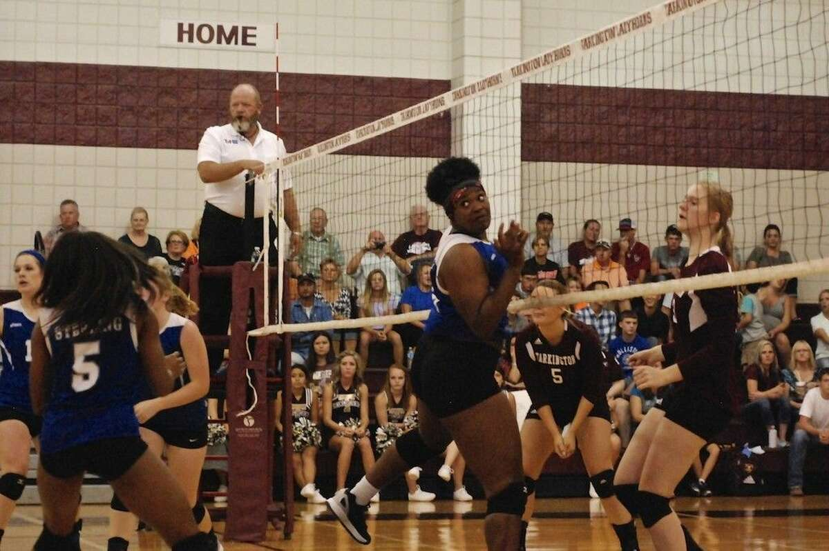 LadyHorns Claire Chapman's attack got passed the block attempt by Baytown Sterling's Sidnee Land.
