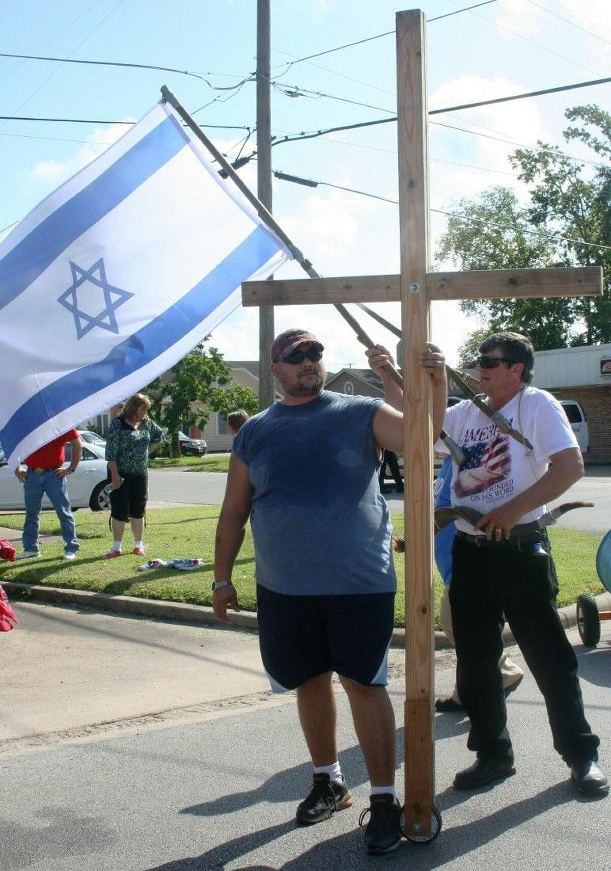 Ken Baker, who is a part of the Covenant with Christ Ministry and Cornerstone Church, carried a cross during the Rally for Israel march, which traveled through Cleveland on Aug. 23.
