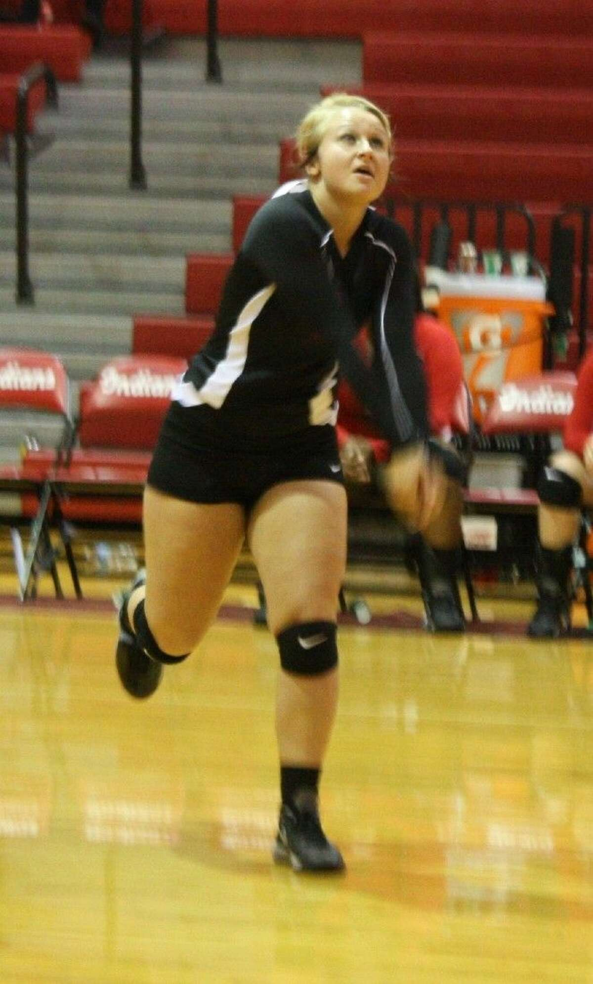 Bailee Burch of the Cleveland Indians prepares to intercept the incoming volleyball.