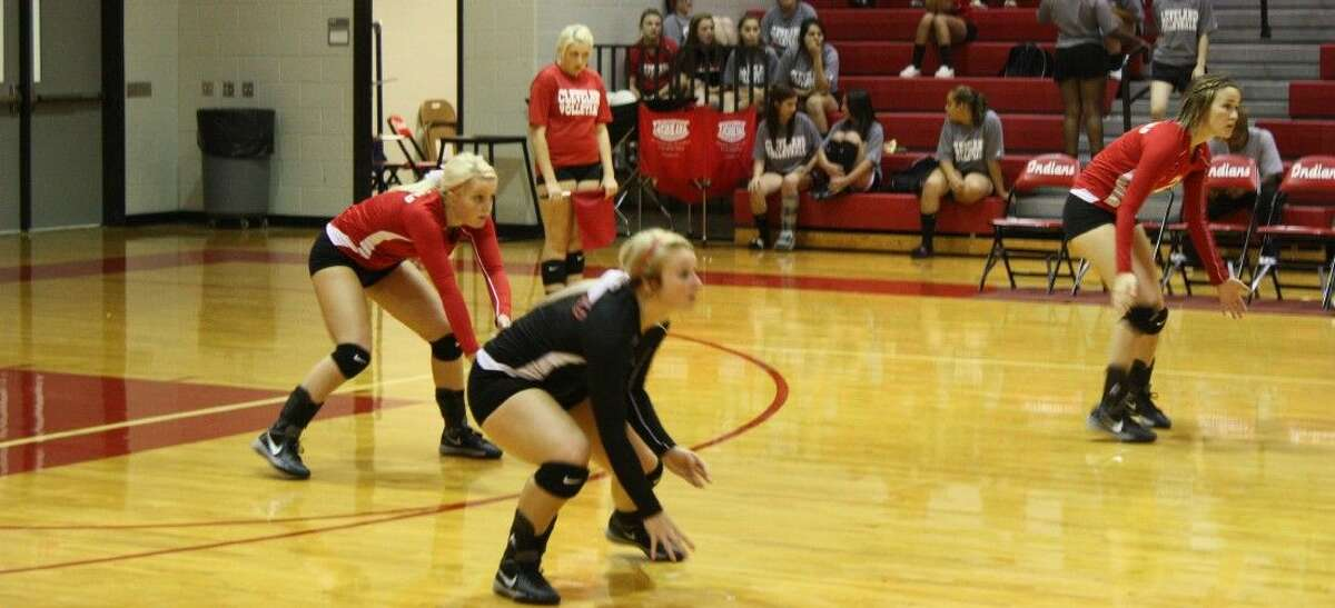 Bailee Burch (middle), Amber Ott (right) and Heather Murff (left) anticipate a serve from the Diboll Lady Jacks.