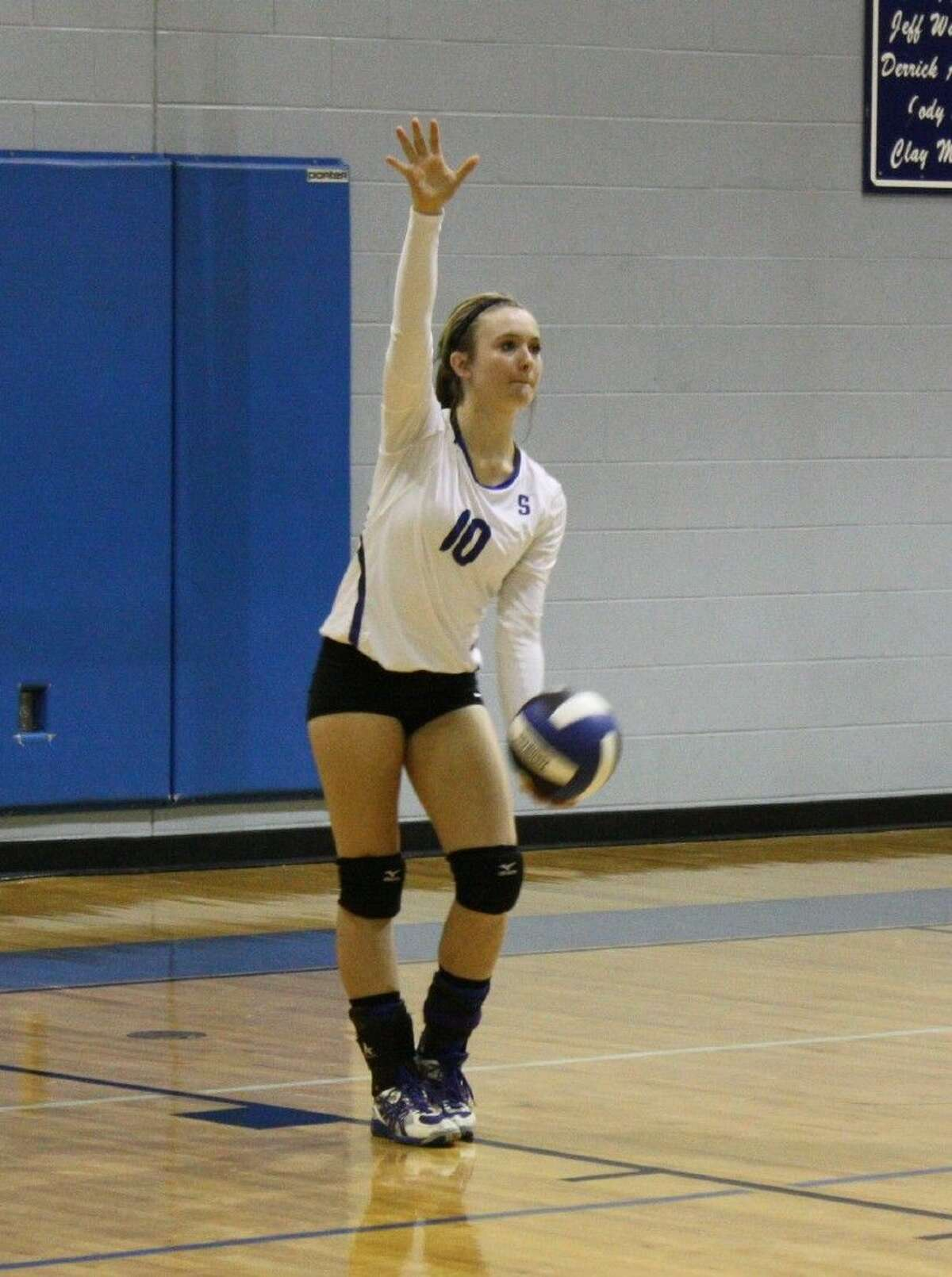 Brittany Keith of the Lady Pirates prepares to serve the ball over to the Groveton Indians' side of the court.