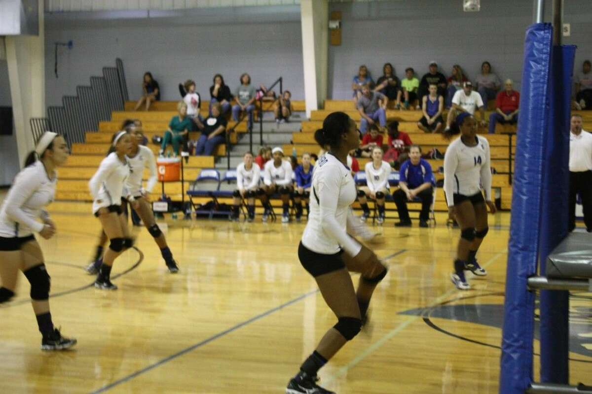 The Lady Pirates prepare themselves for the returning volleyball from the Groveton Indians.