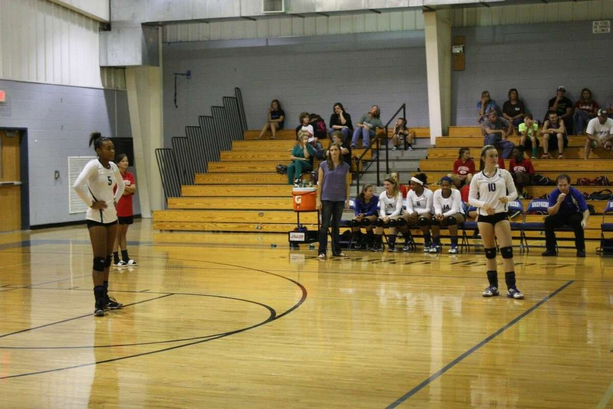 Jasmine Yates (5) and Brittany Keith (10) wait for the Groveton Indians to make a serve.