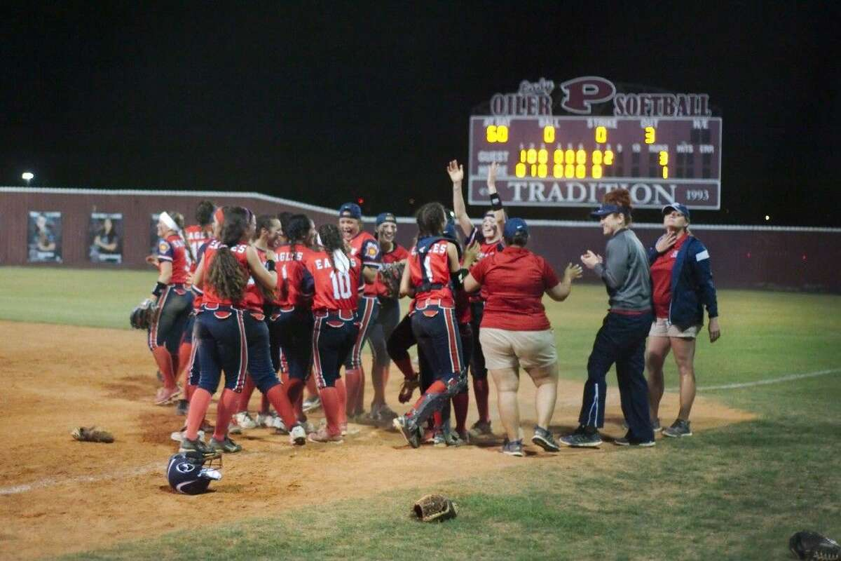 Dawson players celebrate after defeating Pearland, 3-1, in eight innings Friday night at the Lady Oiler complex.