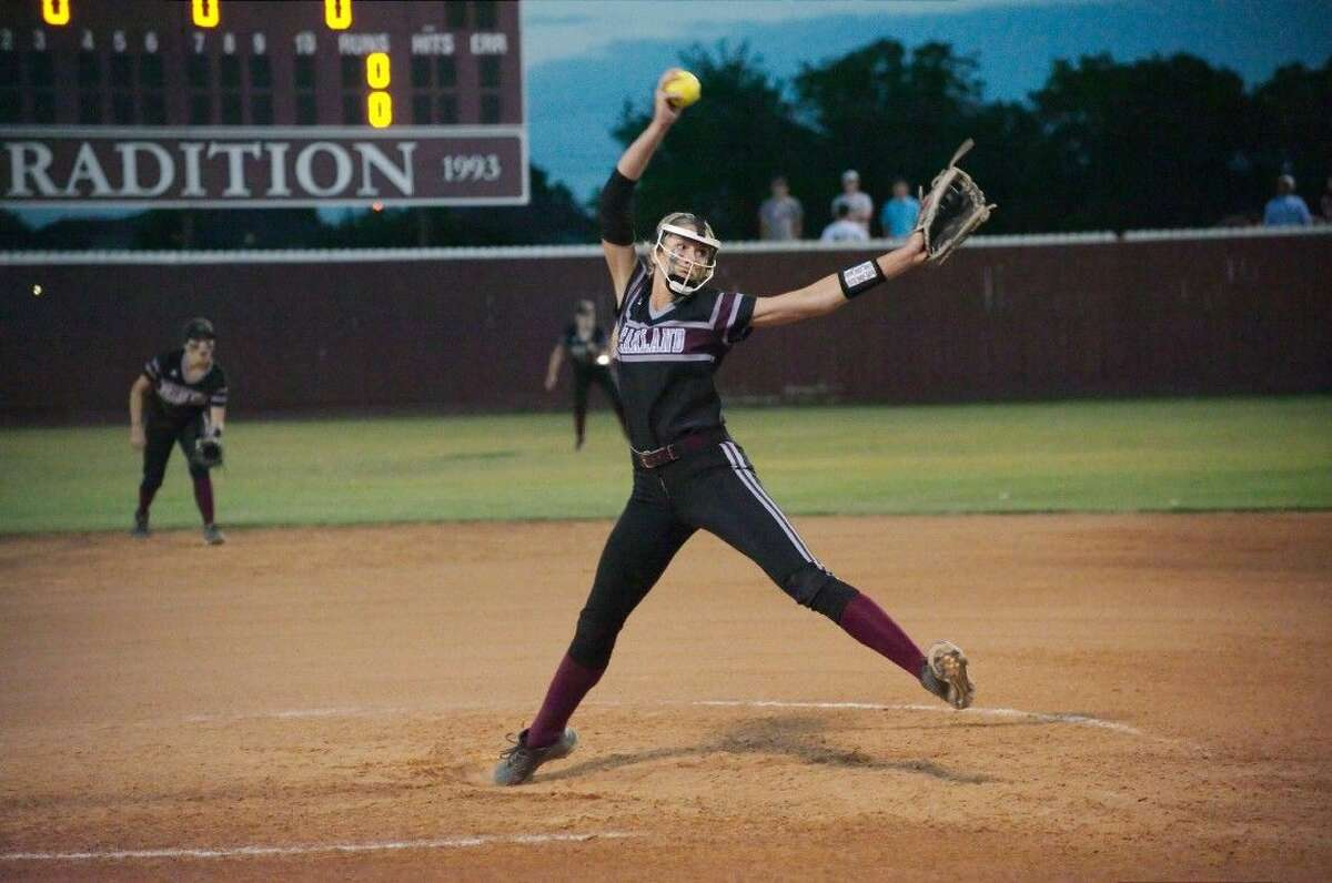Pearland's Alyssa Denham (18) pitches against Dawson Friday night. Denham pitched eight innings and struck out 12.