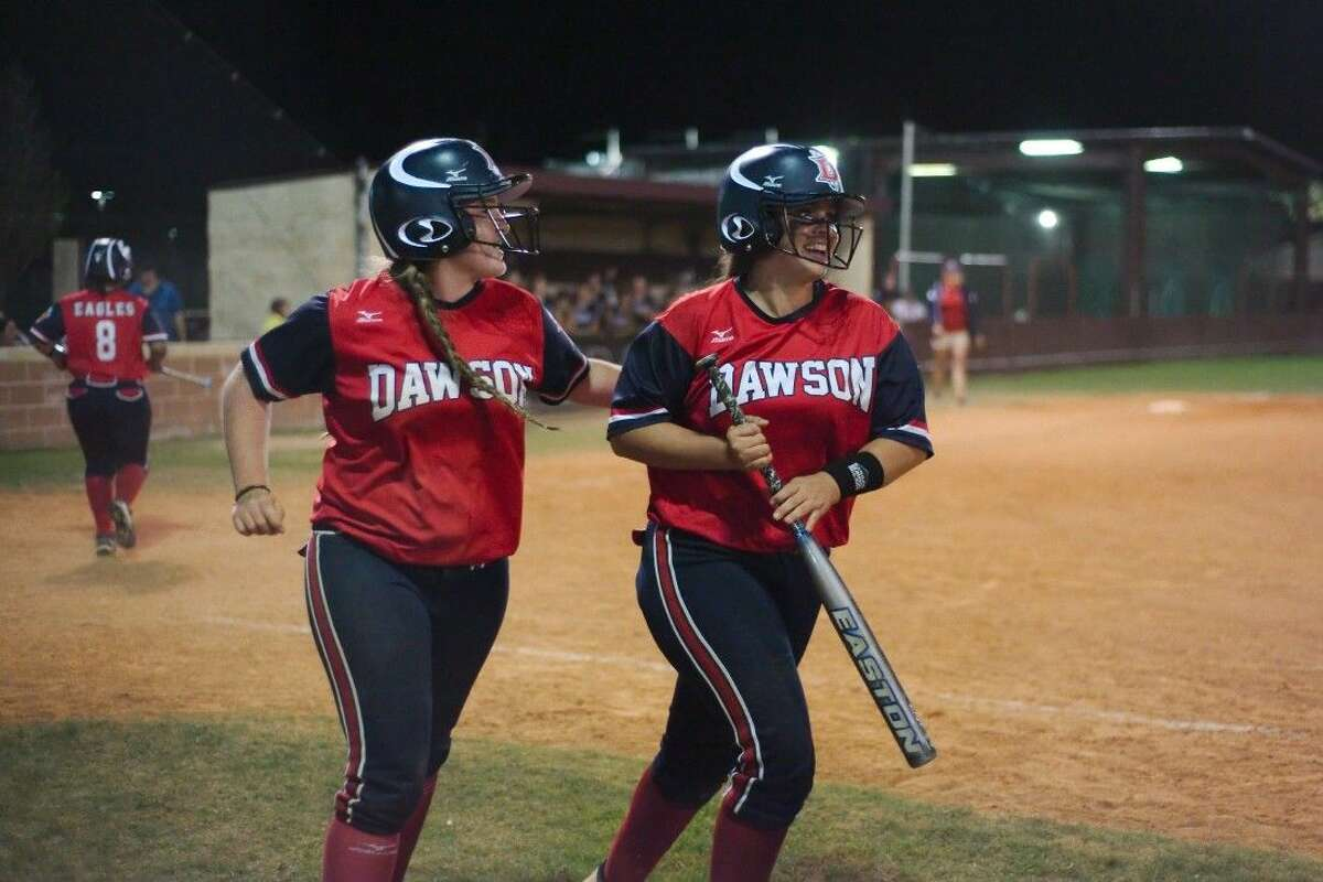 Dawson's Baylee Malone (14) and Amber Stone (9) celebrate the go-ahead runs in the eighth inning against Pearland Friday night.