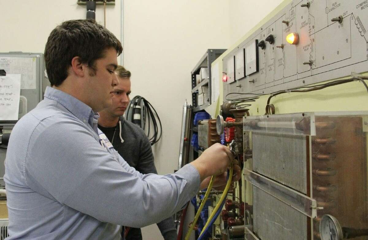 Students in COM's HVAC Program learn hands-on about the components of air-conditioning and heating units.