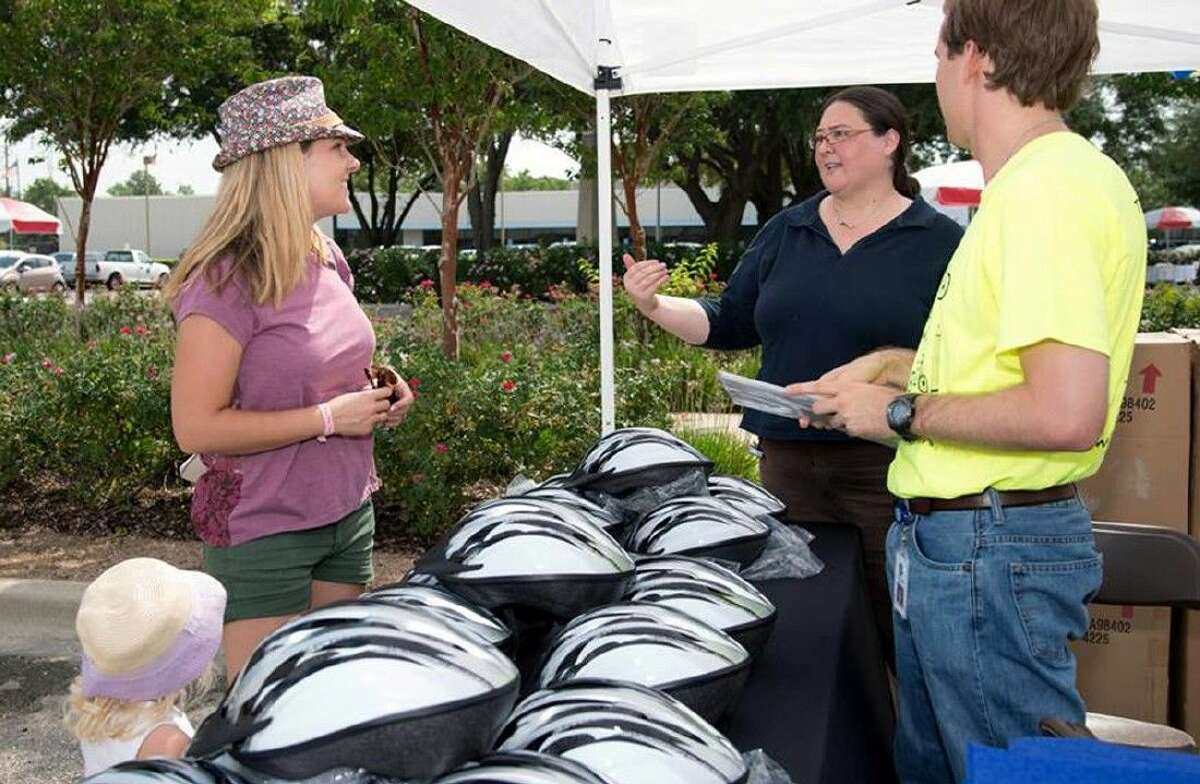 Parks and Streetscapes Development Coordinator Kyle Cooper and Parks and Recreation Development Manager Kimberly Terrell, pictured at right, answer questions and give away helmets.