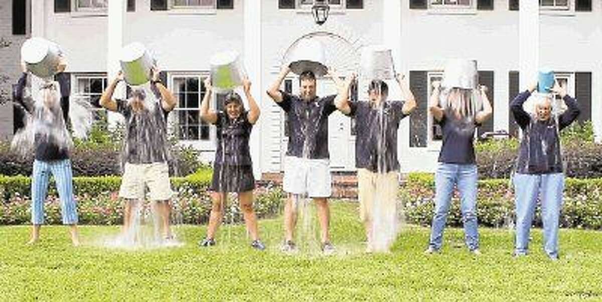 Duchesne Academy administrators take the ALS Ice Bucket Challenge. From left, Mary Ellen Butler, Robert Bagley, Ginger Montalbano, Tony Houle, Don Cramp, Patricia Swenson and Sr. Ann Caire.
