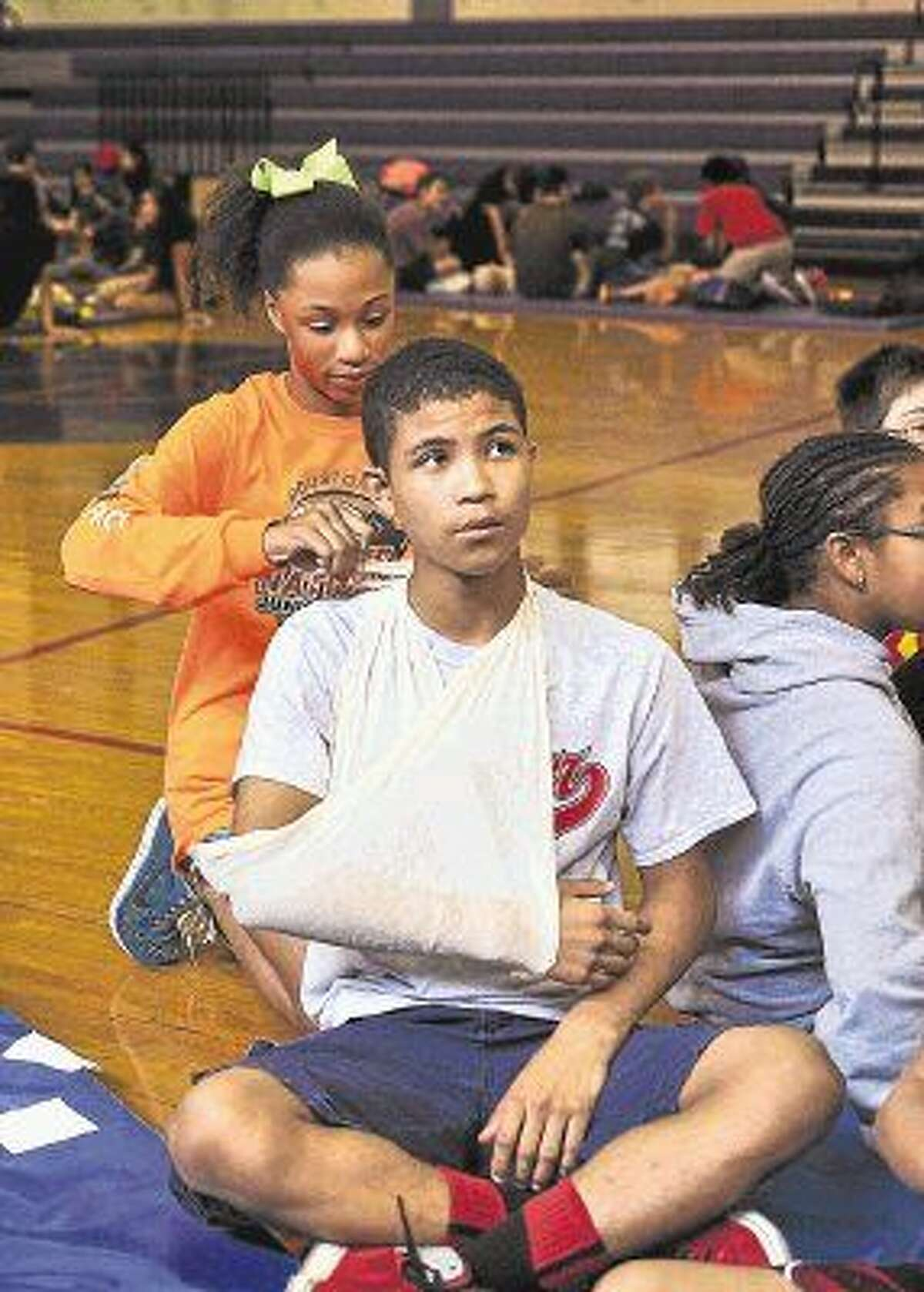 Lanier eighth-graders learned basic first aid as part of their week-long Guidance and Support Group training this summer.