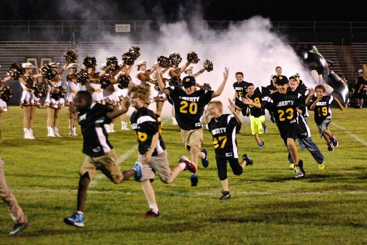 What appeared for a while to be an endless supply of peewee footballers came running across the field at Liberty High School's pep rally Friday, Aug. 22.