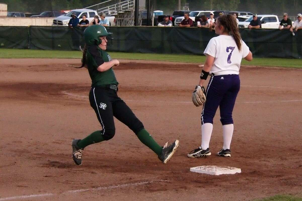 Jessica Husband eases into third after sending a ground ball into right field in the third inning of Kingwood Park's 4-3 win at Dayton on Friday, April 8, 2016.