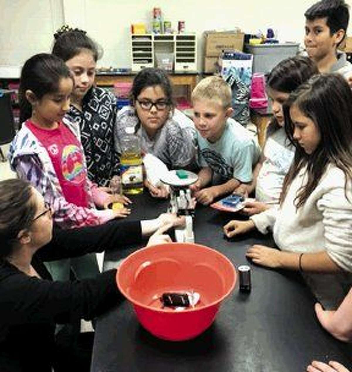 PCE teacher Wendy Miller, works with a group of fifth graders. They will spend three days a week over the next five weeks reviewing key points in science. Their goal is to be successful on their fifth grade STAAR science test.