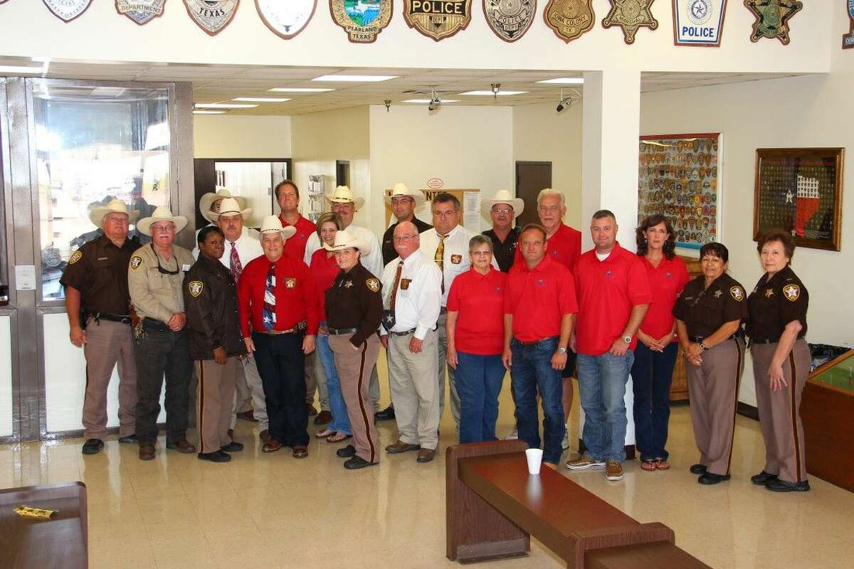 BACH families, members of the 2015 BACH Fun Fest Steering Team, and other Brazoria County Sheriff's Department, and Brazoria County Peace Officers' Association personnel gather to discuss plans for the upcoming 2015 BACH Fun Fest on Saturday, August 22, at the Alvin-Manvel Knights of Columbus Hall.