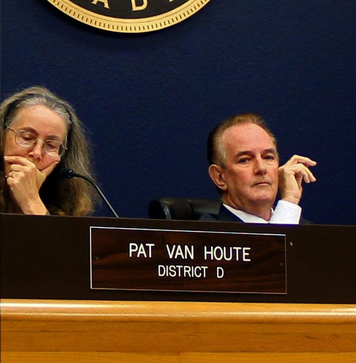 Pasadena City Councilmember Pat Van Houte (left) and Mayor Johnny Isbell (right) listen as city staff members answer questions related to the proposed budget.