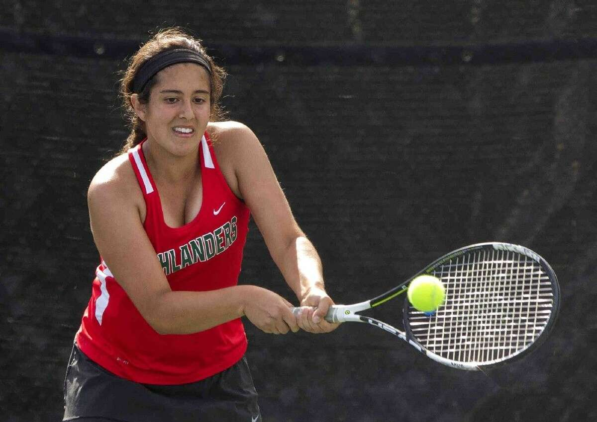 The Woodalnds' Ximena Quevedo returns a serve during a District 16-6A girls doubles tennis match on Thursday at Kingwood High School. Go to HCNpics.com to purchase this photo and others like it.