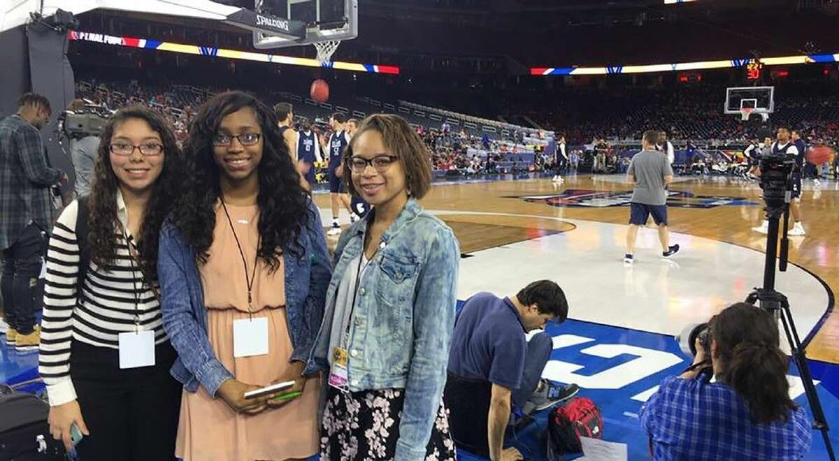 Cypress Lakes High School students (L-R) Katia Villafuerte, Lauren Axel and Kamryn Jones pose for a photo prior to the start of the NCAA Final Four practices during Media Day on April 1 at NRG Stadium.