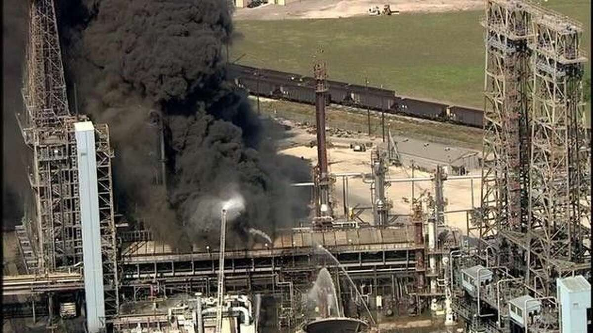 Fire crews work to put out a blaze at the LyondellBasell plant at 100 Allen Genoa Road Friday morning.