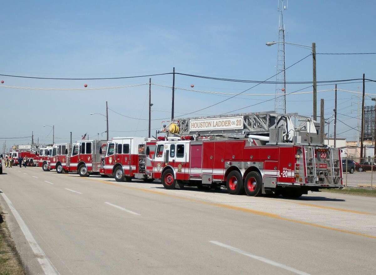 Houston fire trucks line up and stage on Lawndale street in front of the LyondellBasell plant.