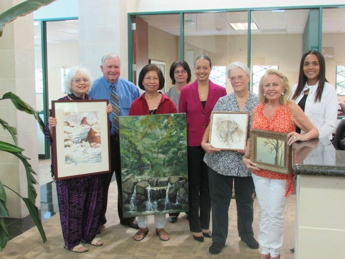 L-R, front row, artist Rona Lesser; artist Magdalena Kraus; artist Sandra Derrick and artist Naomi Stevens. L-R, back ro, J.P. Rose, Vice President Commercial Lending Officer; Tina Grayvill, teller; Jennifer G. Washington, Branch Services Manager and Christina Gonzalez, Lobby Services Representative.