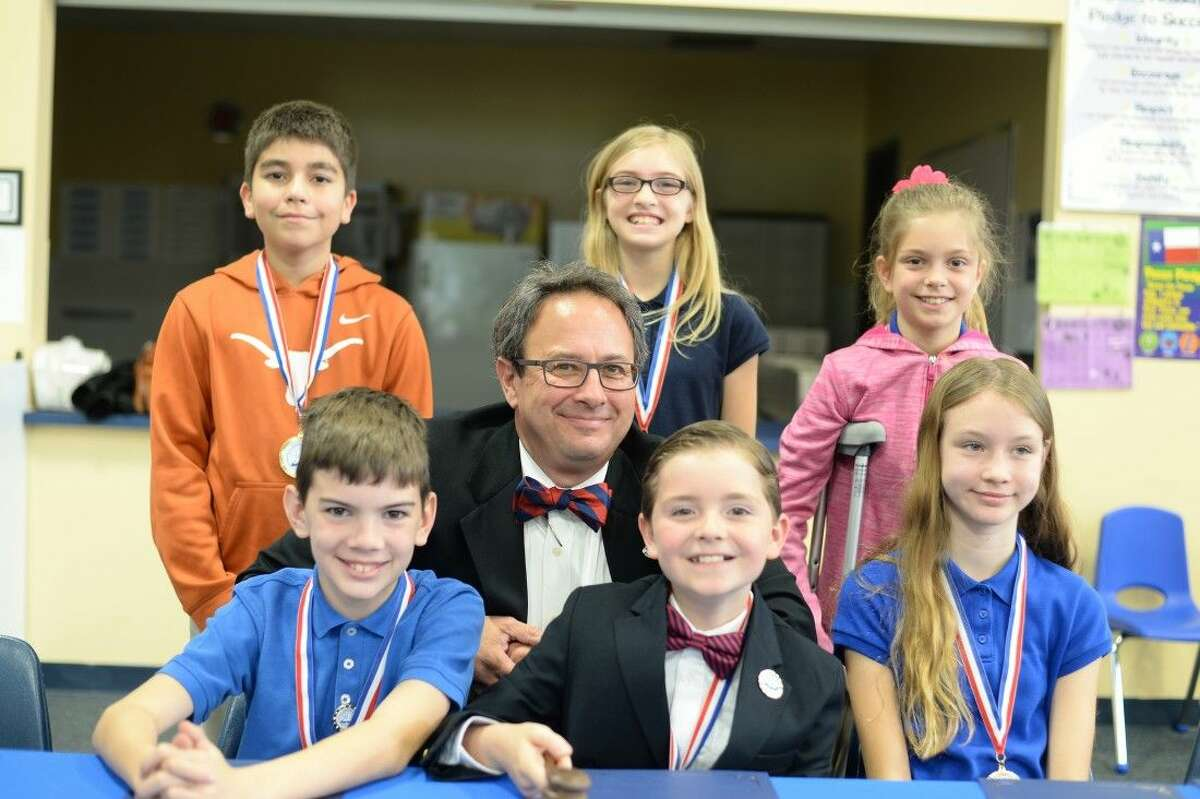 Following the reading of his first proclamation as Mayor for a Day on Monday morning to declare April 4 Odyssey Academy Bay Area Day in El Lago, nine-year old Corbin Burns, surrounded by his council members and El Lago Mayor Robert White (bottom center) officially entered city government.